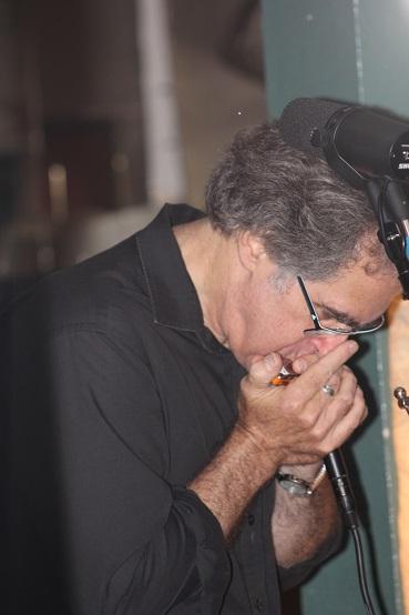 Richard blowing on 50 Grand