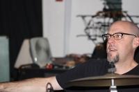 Mark grabbing cymbal