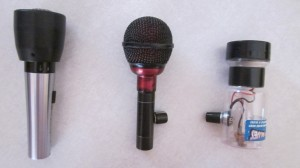 Left to right: Shure 545SD with Bulletizer, Fireball with inline volume control, Bottle o' Blues