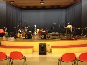 The stage viewed from the audience; the harp setup is just right of center