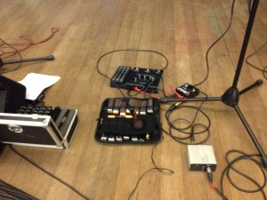My rig, view from front of stage.  L to R: big harp case, small harp case with Audix Fireball, RP360, ABY pedal, direct box.