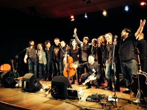 The whole band takes a bow at end of show; Ed Abbiatti in center with arm raised, me to the right next to the bearded guy in the black shirt and jeans